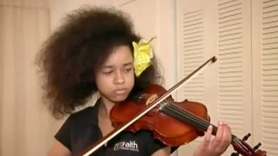 Update: African-American girl won't face expulsion over 'natural hair'