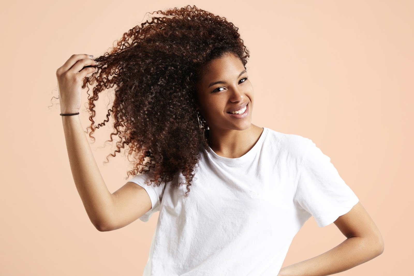 Why Your Black Hair Appears Brown & What To Do About It